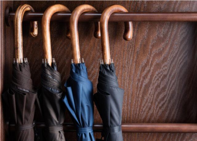 Classic wooden handle umbrellas hanging up